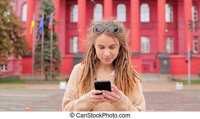 woman with dreadlocks using smartphone - hipster girl ...