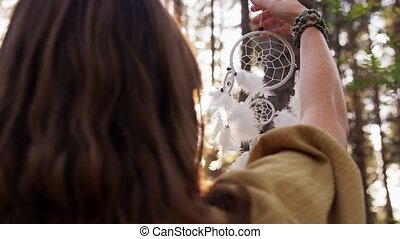 woman with dreamcatcher performing magic in forest - occult ...
