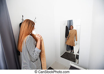 Woman with dress in the checkroom - Woman with dress ...