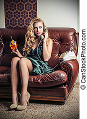 Woman with drink - Woman telephoning while having a drink