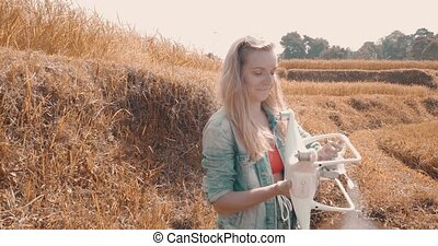 Woman with drone in rice fields