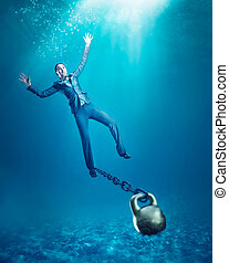 Woman with dumb-bell sinking - Businesswoman with dumb-bell...