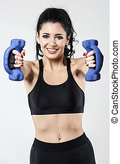 woman with dumbbells doing different exercises