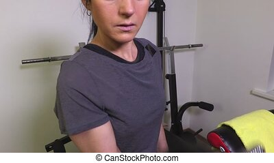 Woman with dumbbells doing exercises for biceps