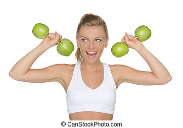 woman with dumbbells from apples looking away