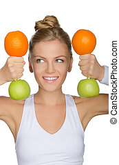 woman with dumbbells from fruuts looking away