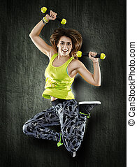 Woman with dumbbells on grunge wall