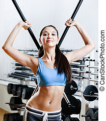 Woman with dumbbells stick in sport centre
