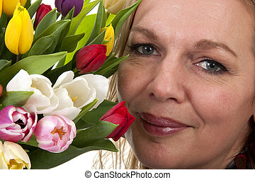 woman with Dutch tulip flowers