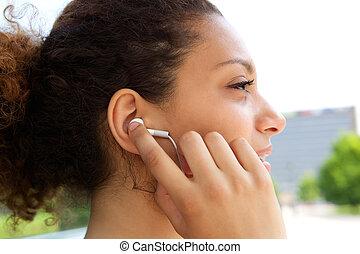 Woman with earphones in ears