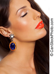 Woman With Earring - Closeup of a model with long dark hair ...