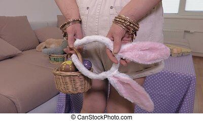 Woman with Easter eggs and bunny ears