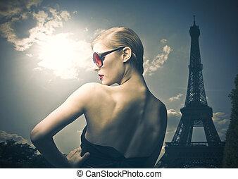 elegant woman with sunglasses in Paris