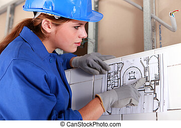 Woman with electrical diagram