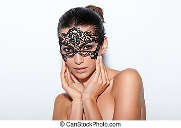 Woman with evening smokey makeup and black lace mask -...