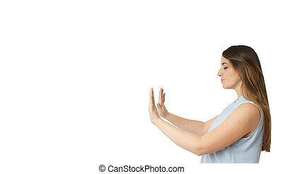 Woman with extended arms and closed eyes pushing something