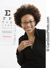 Woman with eye chart
