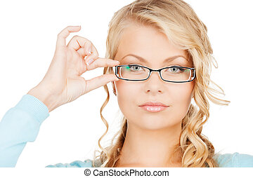 woman with eyeglasses - health and vision concept - close up...