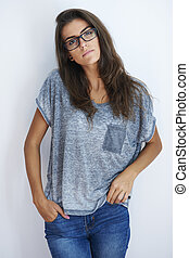Woman with eyewear and hands in pockets