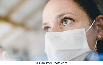 Woman with face masks indoors at home, Corona virus and ...
