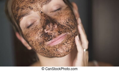 Woman with facial coffee mask