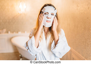 Woman with facial cosmetic mask, skincare