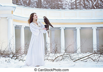 woman with falcon in winter