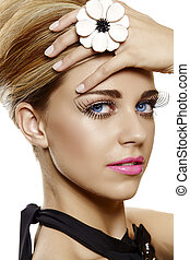 woman with false eyelashes and pink lipstick