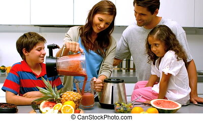 Woman with family pouring fruit coc