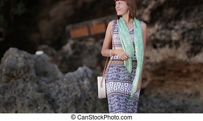 Woman with fashionable stylish yellow white bag on the...