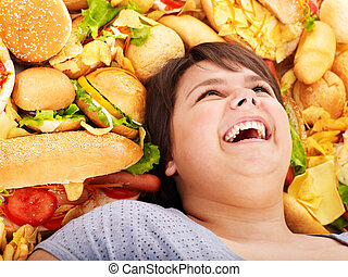 Woman with fast food. - Happy overweight woman with fast...