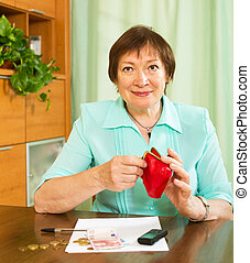 Woman with financial documents and money