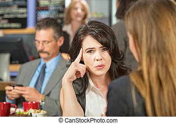 Woman with Finger on Head