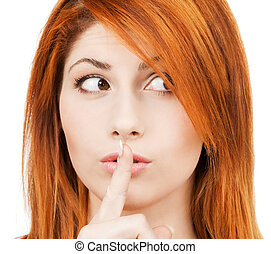 woman with finger on her lips - hush - mysterious woman with...