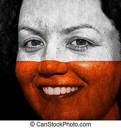 Woman with flag painted on her face to show Poland support