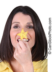 Woman with flower on her nose