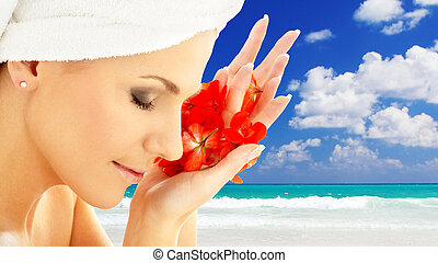 woman with flower petals over resort background