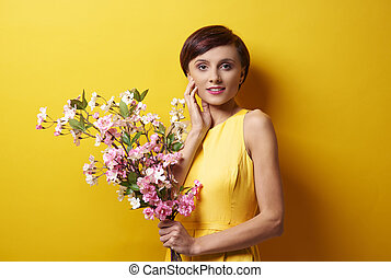 Woman with flowers in the foreground