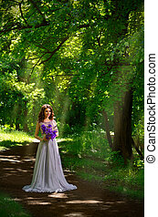 Woman with flowers in the forest (with sunrays ver) - Young...