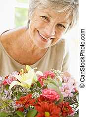 Woman with flowers smiling