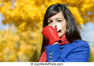 Woman with flu and cold outdoors