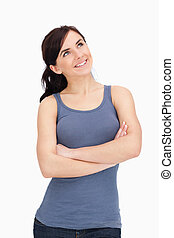 Woman with folded arms looking up