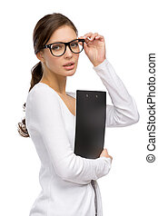 Woman with folder wearing glasses