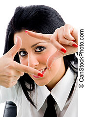 woman with framing hand gesture