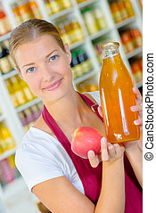 woman with fresh apple juice