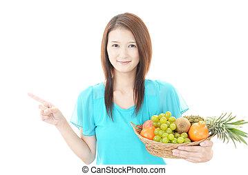 Woman with fresh frutis