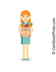 woman with fresh vegetables - Woman holding craft paper bag...