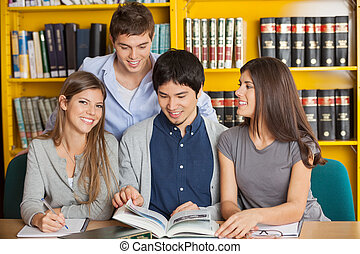 Woman With Friends Studying In University Library