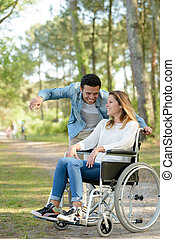 woman with frirn in a wheelchair