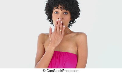 Woman with frizzy hair putting her hand on her mouth